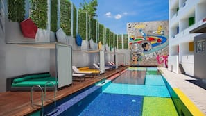 Outdoor pool, open 6 AM to 9 PM, pool loungers