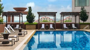 Outdoor pool, open 6:30 AM to 9:00 PM, pool loungers
