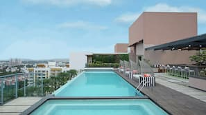 Outdoor pool, open 6:00 AM to 8:00 PM, free pool cabanas, pool umbrellas