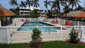 Outdoor pool, open 9:00 AM to 7:00 PM, pool umbrellas, sun loungers