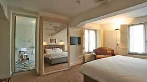 Een kluis op de kamer, een bureau, extra bedden, beddengoed