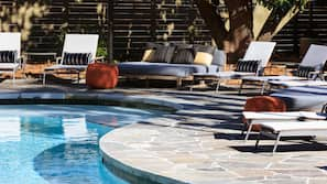 Seasonal outdoor pool, open 7:00 AM to 9:00 PM, sun loungers