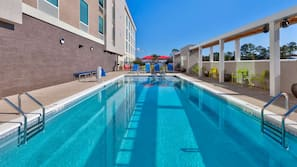 Seasonal outdoor pool, open 9:00 AM to 10:00 PM, pool loungers