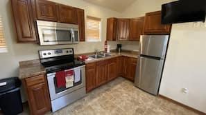 Full-size fridge, microwave, coffee/tea maker, paper towels