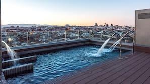 Seasonal outdoor pool, open noon to 8:00 PM, sun loungers