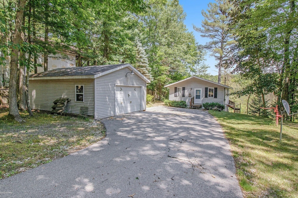, Pentwater River House Frontage Direct on River Overlooking 100s of Wooded Acres