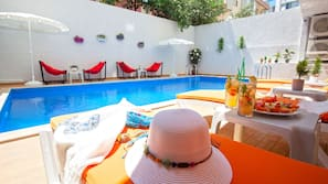 Indoor pool, open 8:00 AM to 6:00 PM, sun loungers