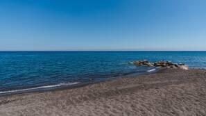 Beach nearby, black sand, 7 beach bars