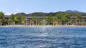 Private beach, black sand, free beach shuttle, sun-loungers