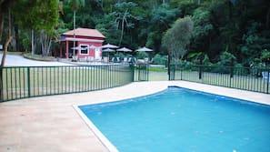 2 indoor pools, outdoor pool, open 10:00 AM to 4:00 PM, pool umbrellas