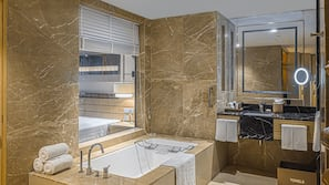 Shower, designer toiletries, hair dryer, bathrobes