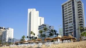 Beach nearby, free beach shuttle, beach umbrellas, beach towels