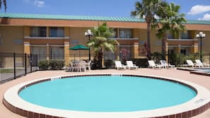 Outdoor pool, open 8:00 AM to 11:00 PM, pool umbrellas
