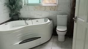 Combined shower/bathtub, towels, soap, toilet paper