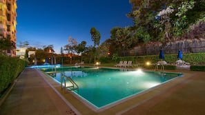 2 outdoor pools, open 7:00 AM to 10:00 PM, pool umbrellas, pool loungers