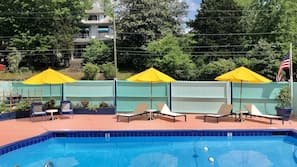 Seasonal outdoor pool, open 9 AM to 10 PM, pool umbrellas, pool loungers
