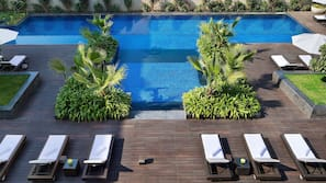 Outdoor pool, open 6:00 AM to 9:00 PM, pool umbrellas