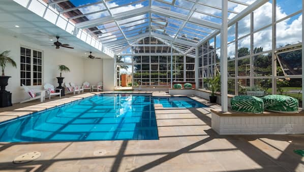 Indoor pool, open 8:00 AM to 8:00 PM, pool loungers