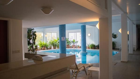 Indoor pool, seasonal outdoor pool, pool umbrellas, sun loungers