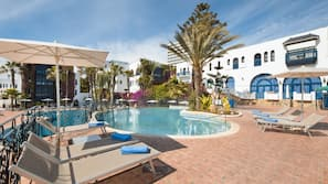 Outdoor pool, open 9:00 AM to 5:00 PM, pool umbrellas, pool loungers