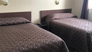 Blackout drapes, iron/ironing board, rollaway beds, free WiFi
