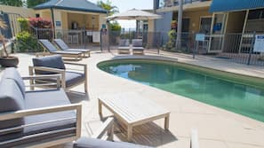 Outdoor pool, open 8:00 AM to 9:00 PM, pool umbrellas, pool loungers