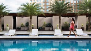 Outdoor pool, open 6:00 AM to 7:00 PM, pool umbrellas, pool loungers