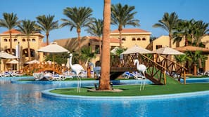 8 outdoor pools, open 7:00 AM to 5:00 PM, pool umbrellas, pool loungers