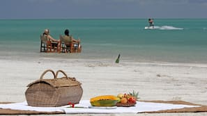 On the beach, white sand, beach towels, fishing