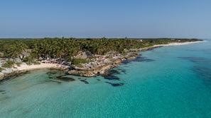 On the beach, sun-loungers, beach towels, beach massages