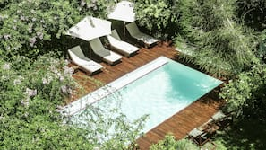 Outdoor pool, open 10 AM to 7 PM, pool loungers