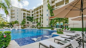 Outdoor pool, open 7:00 AM to 10:00 PM, free cabanas, pool umbrellas