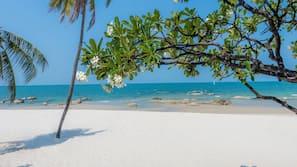 On the beach, white sand, sun-loungers