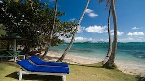 Beach nearby, white sand, sun loungers, beach towels