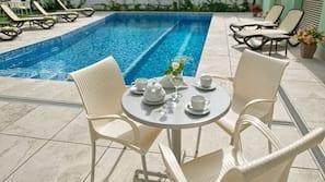 Seasonal outdoor pool, open 8 AM to 9 PM, pool umbrellas, sun loungers