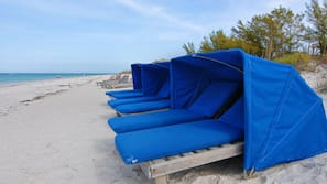 On the beach, beach towels, snorkeling, surfing