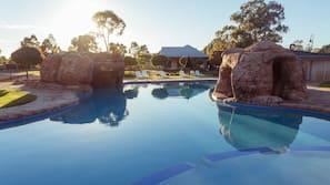 Seasonal outdoor pool, open 8 AM to 9 PM, pool umbrellas, pool loungers