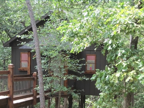 Great Place to stay Eureka Springs Treehouses, Hobbit Caves & Castles near Eureka Springs