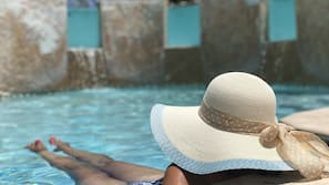 Outdoor pool, open 9:00 AM to 9:00 PM, free cabanas, sun loungers