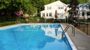 Seasonal outdoor pool, open 6:30 AM to 8:00 PM, pool umbrellas