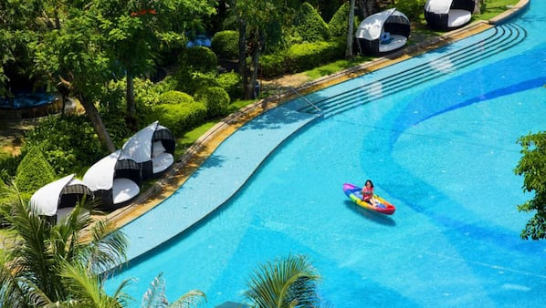 4 outdoor pools, open 8:00 AM to 10:00 PM, pool umbrellas, pool loungers