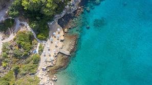In Strandnähe, Cabañas (gegen Gebühr), Liegestühle, Sonnenschirme