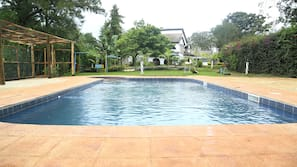 Outdoor pool, open 8 AM to 6 PM, free cabanas, pool umbrellas