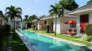 Outdoor pool, open 8:00 AM to 8:00 PM, free pool cabanas, pool umbrellas