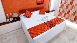 5 dormitorios, caja fuerte, tabla de planchar con plancha y ropa de cama