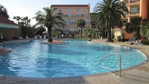 2 outdoor pools, open 10 AM to 11 PM, pool cabanas (surcharge)