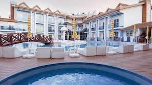 Indoor pool, outdoor pool, free pool cabanas, pool umbrellas