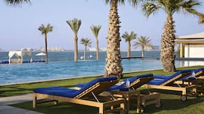 2 outdoor pools, open 9 AM to 9 PM, pool umbrellas, pool loungers