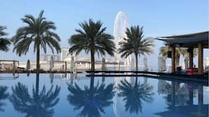 2 outdoor pools, open 9 AM to 9 PM, pool umbrellas, sun loungers