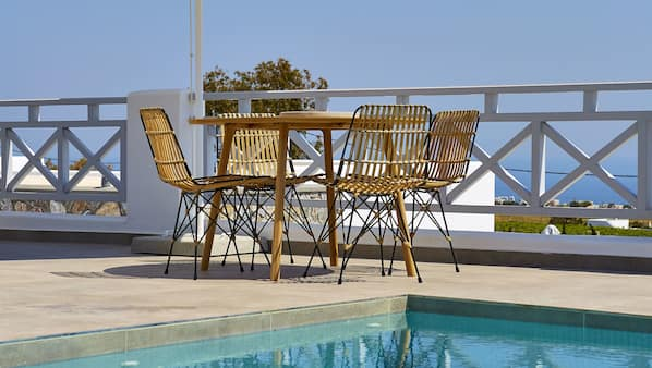 Seasonal outdoor pool, open 9:30 AM to 7:30 PM, sun loungers